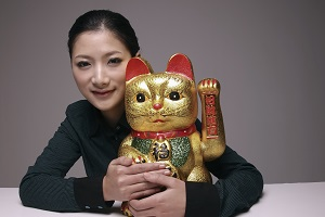 what the many poses of the japanese lucky cat mean maneki