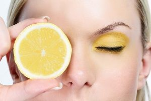 woman-with-sliced-lemon.jpg